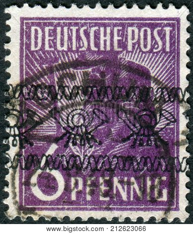 GERMANY - CIRCA 1947: Postage stamp printed in Germany (overpint Type A: US and British occupation zone) shows the Planting Olive circa 1947