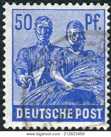 GERMANY - CIRCA 1948: Postage stamp printed in Germany shows Reaping Wheat circa 1948