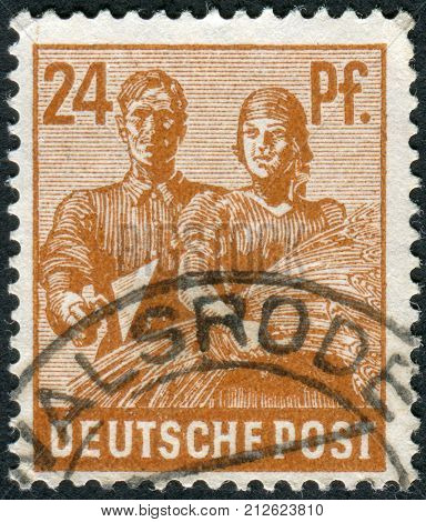 GERMANY - CIRCA 1947: Postage stamp printed in Germany shows Reaping Wheat circa 1947