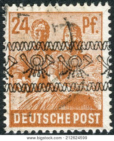 GERMANY - CIRCA 1947: Postage stamp printed in Germany (overpint Type A: US and British occupation zone) shows the Reaping Wheat circa 1947