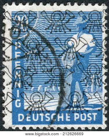 GERMANY - CIRCA 1947: Postage stamp printed in Germany (overpint Type B: US and British occupation zone) shows the sower circa 1947