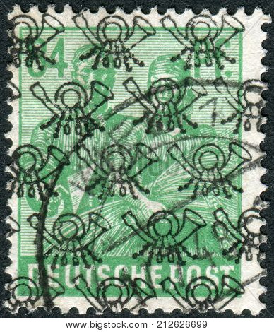 GERMANY - CIRCA 1947: Postage stamp printed in Germany (overpint Type B: US and British occupation zone) shows the Reaping Wheat circa 1947