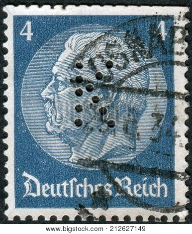 GERMANY - CIRCA 1934: Postage stamp printed in Germany (German Reich) with perfin