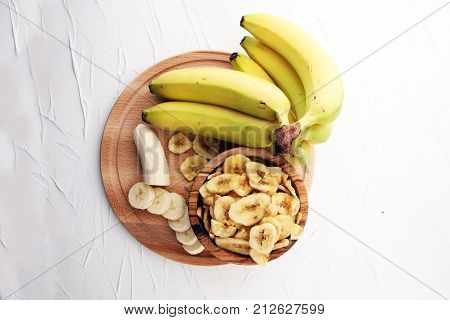 dried banana on white background.Homemade Dehydrated Banana Chips.