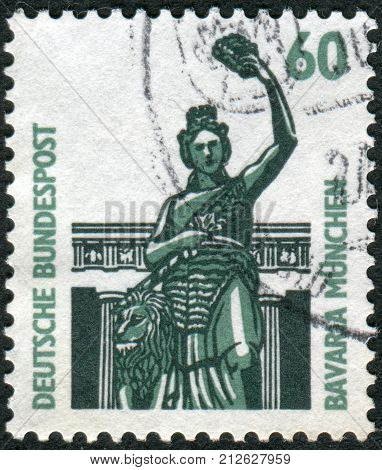 GERMANY - CIRCA 1987: Postage stamp printed in Germany dedicated to Bavaria Munich shows Bronze statue above the Theresienwiese Hall of Fame circa 1987