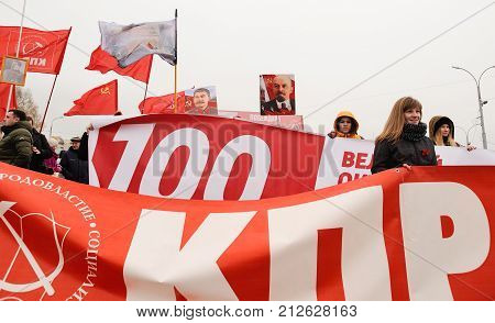 Orel, Russia, November 7, 2017: October Revolution Anniversary Meeting. Red Communist Banners, Lenin