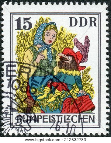 GERMANY (DDR) - CIRCA1976: Postage stamp printed in Germany shows a scene from a fairy tale by the Brothers Grimm Rumpelstiltskin circa 1976