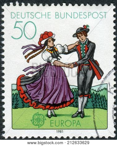 GERMANY - CIRCA 1981: Postage stamp printed in Germany shows South German couple dancing in regional costumes (region Black Forest) circa 1981