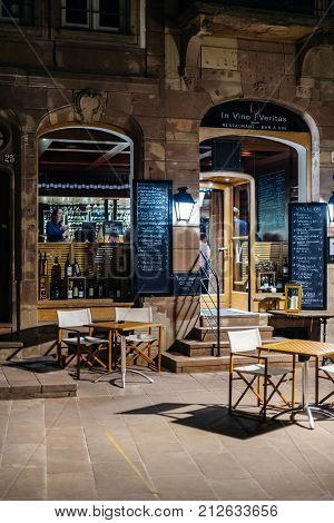 STRASBOURG FRANCE - OCT 31 2017 In Vino Veritas wine and other alcoholic drinks meat restaurant club at night with people customers inside
