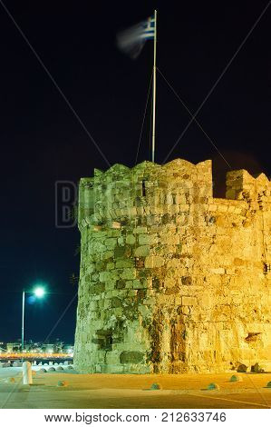 Greek flag on the fortification of the Venetian fortress medieval fortress of the city of Kos