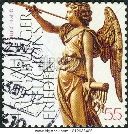 GERMANY - CIRCA 2005: Postage stamp printed in Germany dedicated to the 450th anniversary of the Peace of Augsburg an angel with a trumpet circa 2005