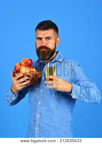 Man With Beard Holds Bowl Of Fruit And Juice