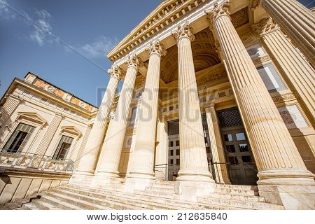View from above on the Justice palace building with beautiful columns in Nimes city in southern France