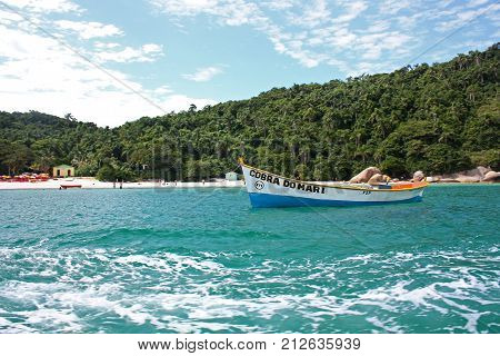 ILHA DO CAMPECHE, FLORIANOPOLIS, SANTA CATARINA, BRAZIL - MARCH 23, 2009: A boat in over the clear water of the sea, near the coast of Campeche island.