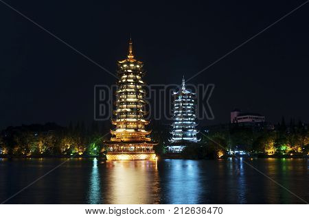 The Sun and Moon Twin Pagodas illuminated at nigh in the city of Guilin China