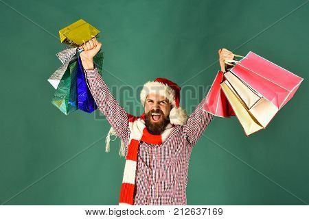 Guy Or Hipster Shopper In Red Hat With Shopping Bags