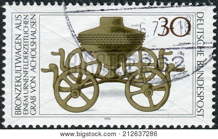 GERMANY - CIRCA 1976: Postage stamp printed in Germany shows the Archaeological Treasures: Bronze ritual chariot c. 1000 B.C. circa 1976