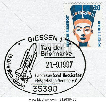GERMANY - CIRCA 1989: Postage stamp printed in Germany shows a Queen Nefertiti bust Egyptian Museum Berlin. Stamp of 1997 devoted to the 40th anniversary of spaceflight circa 1989