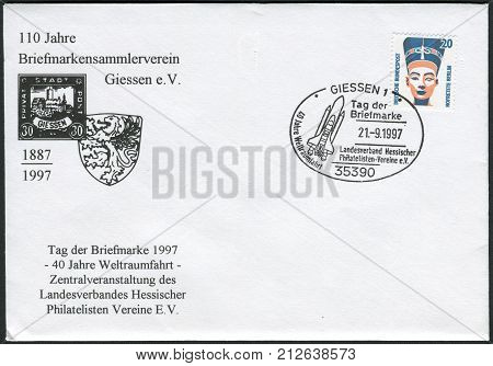 GERMANY - CIRCA 1989: Postage stamp and envelope printed in Germany shows a Queen Nefertiti bust Egyptian Museum Berlin. Envelope and stamp of 1997 devoted to the 40th anniversary of spaceflight circa 1989