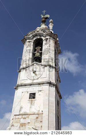 Isolated in front of the Ajuda Palace is the clock-tower also called the Tower of the Rooster in Lisbon Portugal