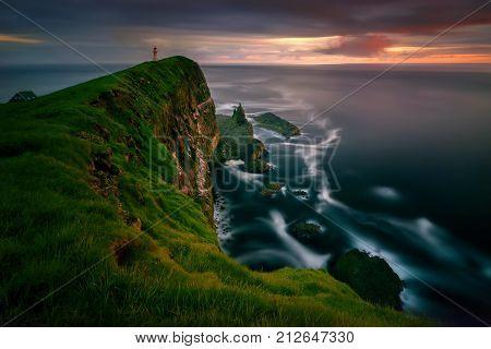 Mykinesholmur island and lighthouse in sunset light Faroe Islands