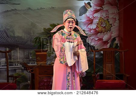 CANTON, CHINA - CIRCA OCTOBER 2017: A singer of Cantonese opera performers in the Museum of Cantonese opera.