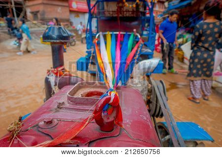 BHAKTAPUR, NEPAL - NOVEMBER 04, 2017: Close up of a small truck at Taumadhi Square in Bhaktapur, Valley, Nepal.