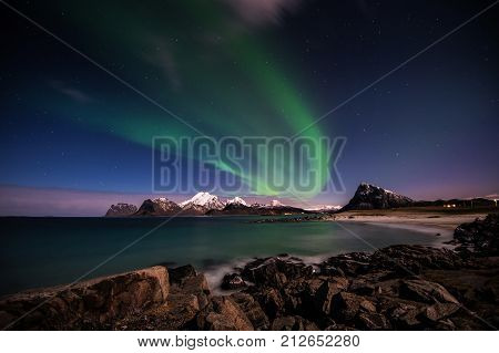 Northern lights above Himmeltindene. In Lofoten we live beneath the Auroral Oval. This is a belt of light that encircles the geomagnetic poles, and here your have the best chance of seeing the Northern  lights