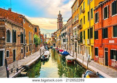Venice cityscape rio San Barnaba and Fondamenta del Squero water canal campanile church on background building and boats. Italy Europe.