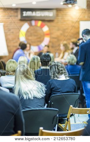 Conference and Mediation at The Round Table.Group of Professional Mediators Presenting at the Round Table on Stage Before the Audience.Vertical Image Orientation