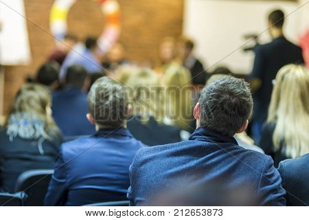 Mediation at The Round Table.Group of Professional Mediators Presenting at the Round Table on Stage Before the Audience. Horizontal Image Composition