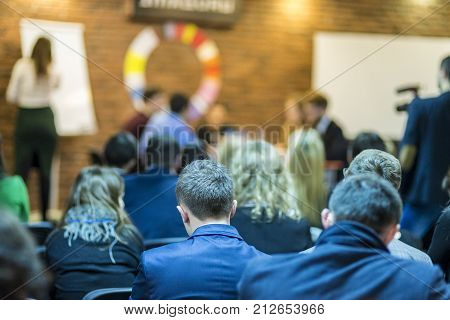 Mediation at The Round Table.Group of Young Professional Mediators Having a Public Discussion at the Round Table on Stage Before the Audience. Horizontal Image Composition