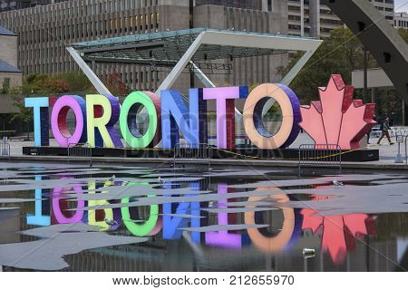 Toronto Canada - Oct 11 2017: Colorful illuminated Toronto sign at the Nathan Phillips Square in Toronto Canada