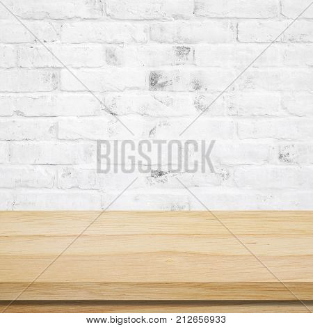 Empty wooden table over white brick wall background tabletop shelf counter design for product display montage background