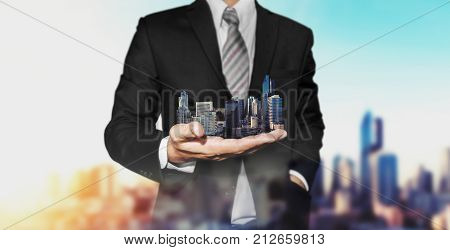 Real estate property concept, Business real estate agent holding modern buildings on hand
