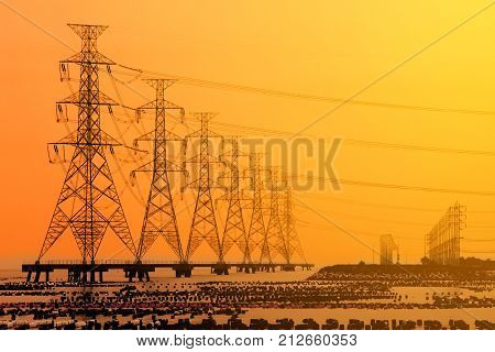 High voltage electric transmission tower energy pylon in the sea.