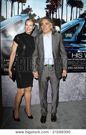LOS ANGELES - MAR 22:  Kelly Lynch, Mitch Glazer arriving at the Los Angeles HBO Premiere of 'His Way' at Paramount Studios in Los Angeles, California on March 22, 2011.
