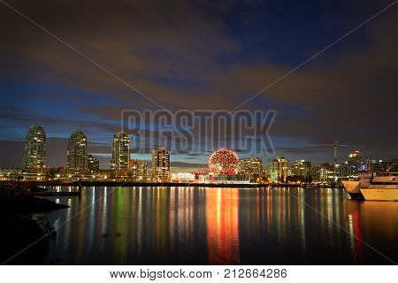 Twilight, False Creek, Vancouver. Morning twilight on the Vancouver skyline on the edge of False Creek including condominium towers and the geodesic dome of Science World. British Columbia, Canada.