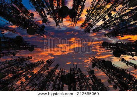 Silhouette of the antenna of cellular cell phone and communication system tower with Beautiful sunset sky color dark tone Telecommunication tower perspective. technology and industrial concept.