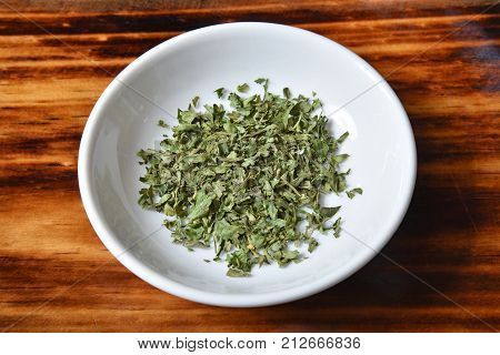 High angle view of a bowl of parsley flakes