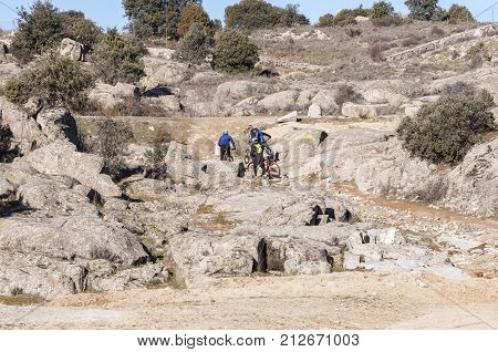 COLMENAR VIEJO - FEBRUARY 8 2015: Mountainbikers in Guadarrama Mountains Colmenar Viejo Madrid Spain on February 8 2015