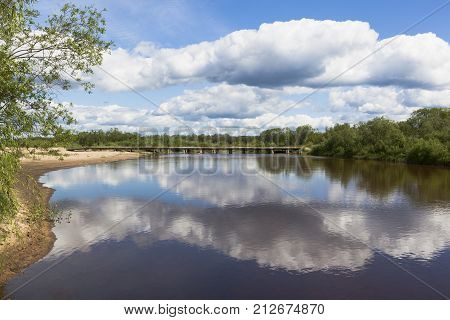 Vaga River and a wooden road bridge near the village of Klopovskaya, Velsky district, Arkhangelsk region, Russia