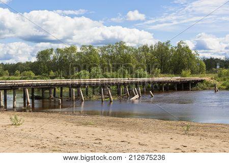 Wooden road bridge near the village of Klopovskaya, Velsky district, Arkhangelsk region, Russia