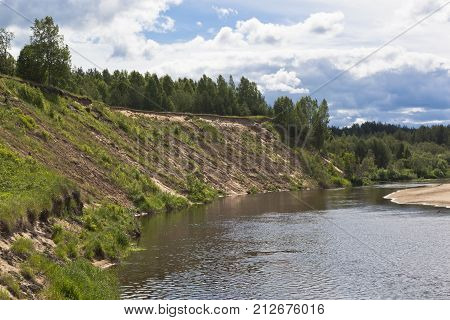 Steep bank of the river Vaga. River View near the village Undercity, Velsky district, Arkhangelsk region, Russia