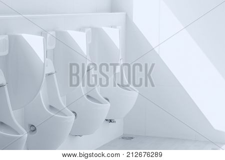 Hygiene urinals men public toilet white ceramic in toilet room urine man bathroom with UV sun shade
