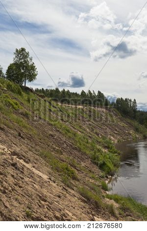 Steep bank of the river Vaga near the village Undercity, Velsky district, Arkhangelsk region, Russia