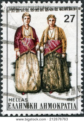 GREECE - CIRCA 1985: A stamp printed in Greece shows the traditional female dress of the region Pontus circa 1985