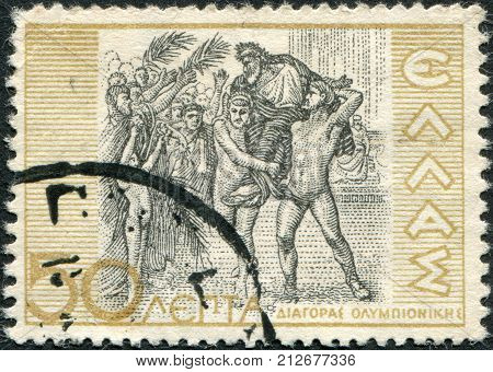 GREECE - CIRCA 1937: Postage stamps printed in Greece, shows Diagoras of Rhodes, Victor at Olympics, circa 1937