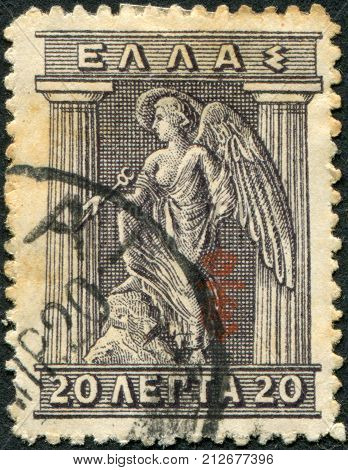 GREECE - CIRCA 1916: Postage stamps printed in Greece, shows Iris Holding Caduceus, circa 1916
