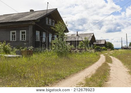 Houses in the village street. Forest settlement Undercity, Velsky district, Arkhangelsk region, Russia